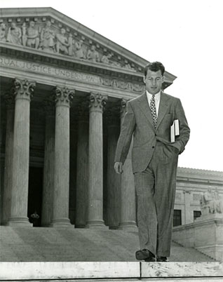 Byron R. White shown leaving the Supreme Court Building while serving as a law clerk to Chief Justice Fred Vinson, September 1946.
