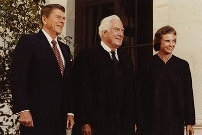 President Ronald Reagan with Chief Justice Warren E. Burger and Justice Sandra Day O'Connor on the day of her investiture ceremony at the Supreme Court, September 25, 1981.
