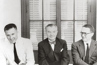 Justice Robert H. Jackson (center) with his law clerks, William H. Rehnquist (left) and C. George Niebank, Jr. (right). 1952.