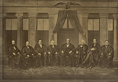 The Chase Court, March-April 1868. From left: Justices Stephen J. Field, Samuel F. Miller, Nathan Clifford and Samuel Nelson, Chief Justice Salmon P. Chase, and Justices Robert C. Grier, Noah H. Swayne, and David Davis.