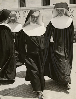 Sister Ann Joachim (far right) walking outside of the Supreme Court Building. Acme Newspictures, Inc.