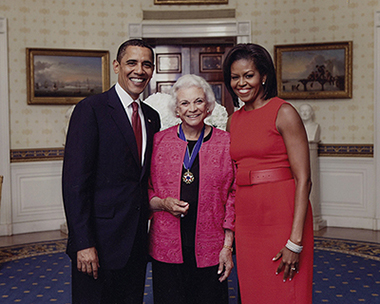 President Barack Obama, Justice Sandra Day O'Connor, and First Lady Michelle Obama pose for a photograph in the Blue Room following the Presidential Medal of Freedom presentation ceremony at the White House.